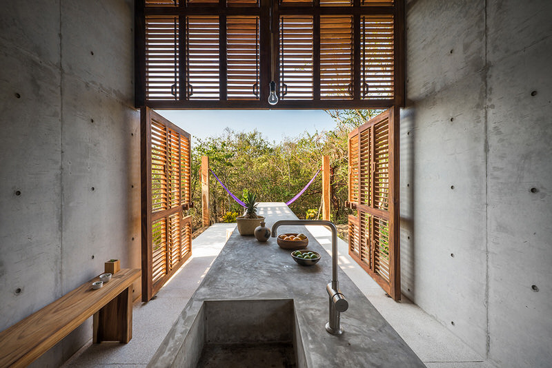 Casa-Tiny-Built-In-Concrete-Furniture-Spanning-Outside